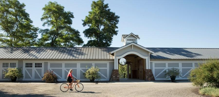Cyclist pauses to admire the scenery at Walla  Walla's Abeja Inn