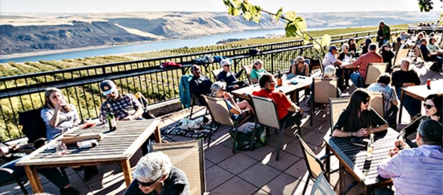 /Visitors taste from Maryhill deck overlooking the Columbia River