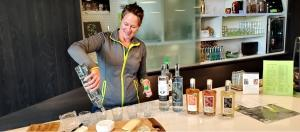 Kim Karrick pours an array of spirits at Scratch Distillery