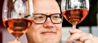 WSU wine researcher Jim Harbertson enjoys, admires and carefully weighs the hues, shades and tints of rosé wine.