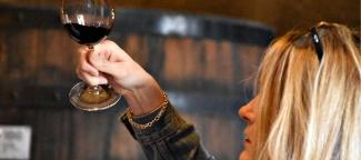 A student tastes wine during a 2020 leadership conference co-sponsored by Gonzaga University Wine Institute.