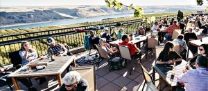 Wine tasters enjoy a spectacular setting above the Columbia at Maryhill Winery in Goldendale.