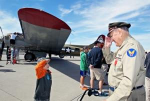Young man salutes Capt. Bill Purple, a decorated B-17 pilot