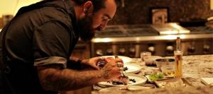 Chef Austin Harmon adds finishing touches on a plate for wine dinner