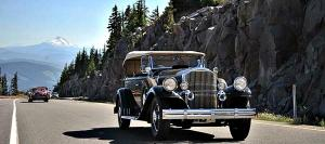 An elegant touring car proceeds on its southward journey from Seattle
