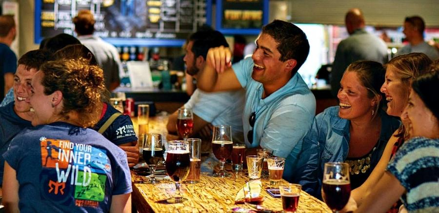 Guests enjoy the atmosphere and the beer at Mike Hess Brewing in San Diego