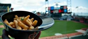 Garlic fries aen't a new item at AT&T Park, but now you can have them in a miniature batting helmet